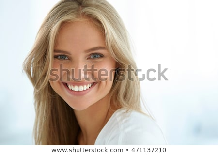 Attractive blonde girl with tooth care. Stock photo © justinb