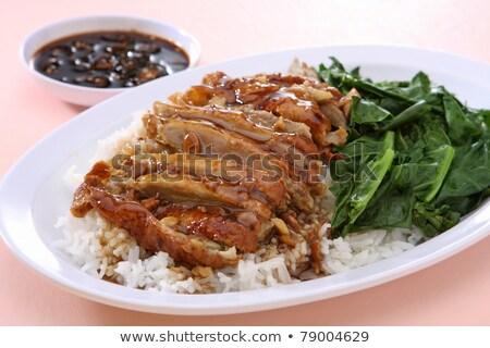 roast duck over rice stock photo © aeyzrio