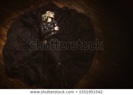 Woman with a stunning body lying on floor Stock photo © tommyandone
