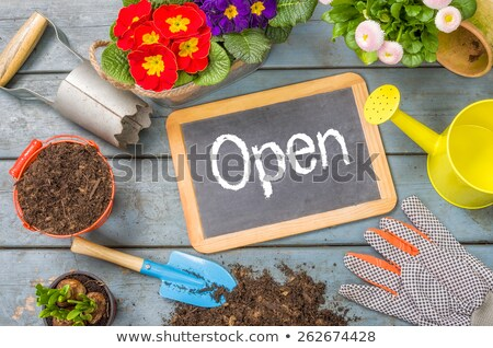 blackboard on a plant table with garden tools   open stock photo © zerbor