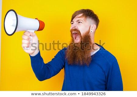 Handsome hipster talking through megaphone Stock photo © wavebreak_media
