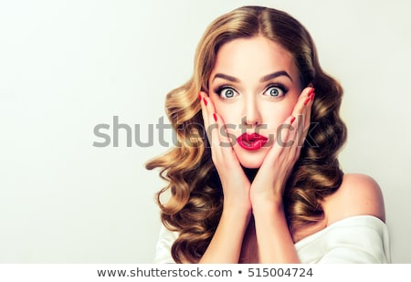 Beautiful smiling woman looking at your product isolated on whit Stock photo © leventegyori