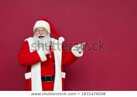 happy senior business man wearing santa claus hat presenting stock photo © feedough