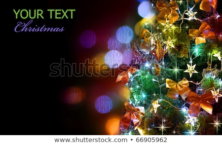 Stock photo: blue green night lights bokeh over dark background