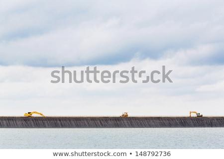 backhoe on dam crest stock photo © smuay