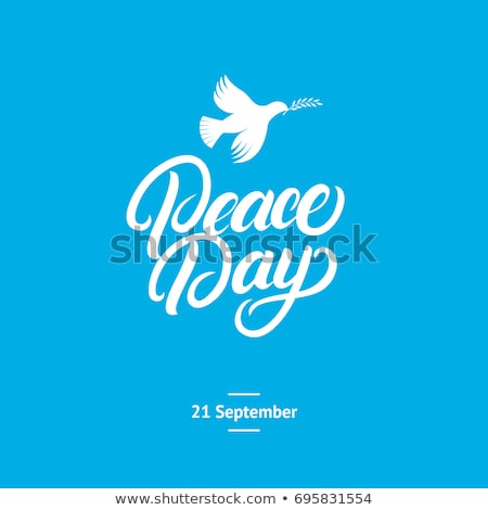 Peace Day lettering text. Pigeons Stock photo © orensila
