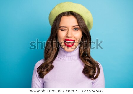 closeup of blue eyed girl smiling stock photo © ralanscott