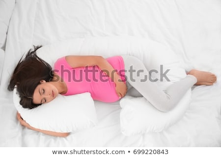 pregnant woman sleeping in bed at home stock photo © dolgachov