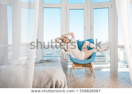 Woman near curtain Stock photo © deandrobot