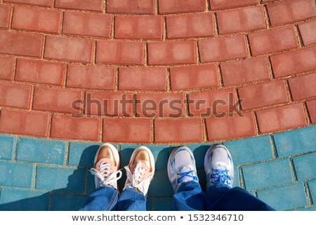 Modern new sneakers on concrete sidewalk surface Stock photo © stevanovicigor