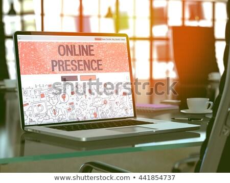 Laptop tela on-line moderno local de trabalho Foto stock © tashatuvango