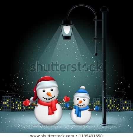 Christmas snowmans pillar and night city Stock photo © romvo