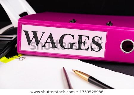 wages on folder blurred image stock photo © tashatuvango