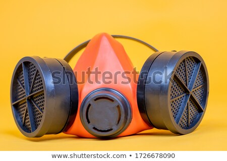a man in a gas mask protesting against polluted air environment stock photo © studiostoks