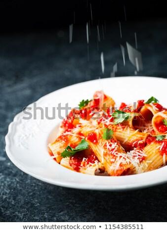 rustic italian rigatoni pasta cheese grating motion blur Stock photo © zkruger