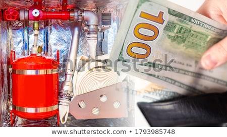 firefighter man money stock photo © toyotoyo