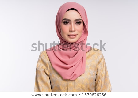 Portrait of young Muslim woman in traditional clothes stock photo © Traimak