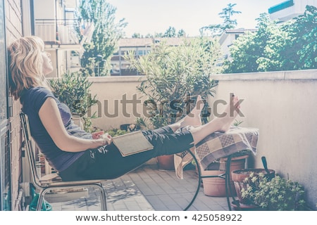 Stock photo: Woman reading book and daydreaming