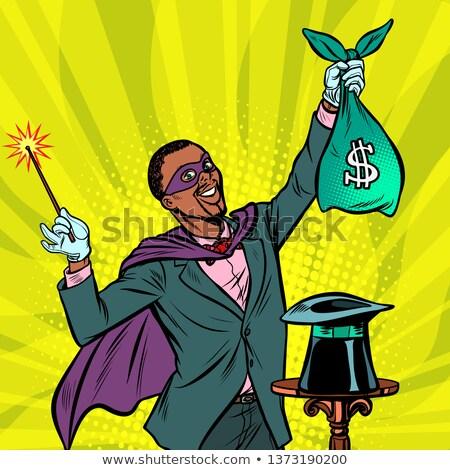 African Magician with dollar money Stock photo © studiostoks