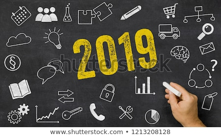 2019 written on a blackboard with icons stock photo © zerbor