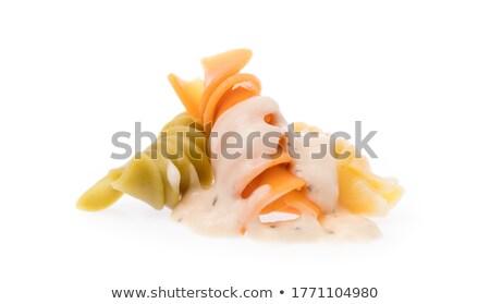 Macaroni carbonara on a white dish and orange background Stock photo © Imaagio
