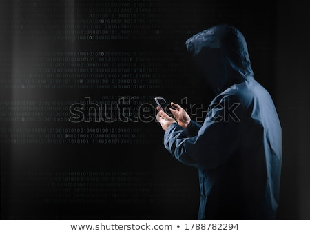 hacker with smartphone and computers in dark room Stock photo © dolgachov