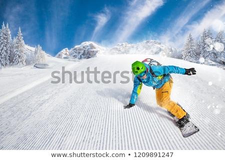 Active man snowboarding Stock photo © Anna_Om
