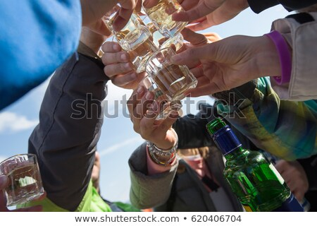 hands of alcoholic drinking vodka shots at night Stock photo © dolgachov