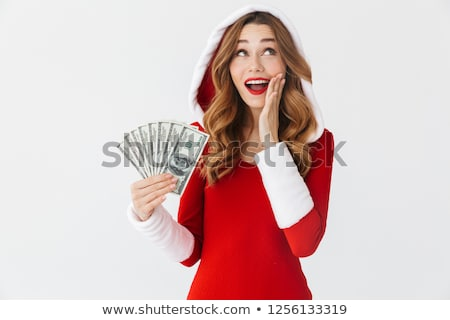 image of brunette woman 20s wearing red dress holding fan of mon stock photo © deandrobot