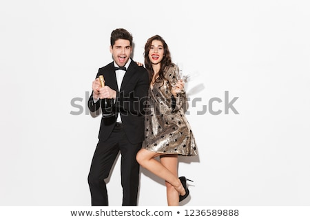 cheerful young smartly dressed celebrating stock photo © deandrobot