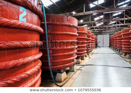 Wooden barrels in a fish sauce factory on Phu Quoc island Stock photo © galitskaya