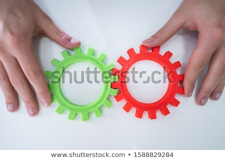 Stock photo: Businessperson Joining Gears On Desk