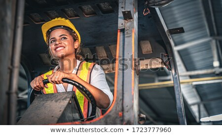loader in helmet with cargo at warehouse Stock photo © dolgachov