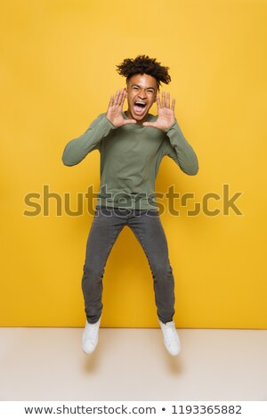 full length photo of pleased african guy having stylish afro hai stock photo © deandrobot