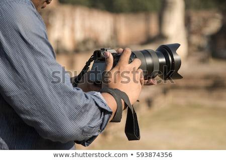 мужчины фотограф камеры Постоянный за пределами городской улице Сток-фото © artfotodima