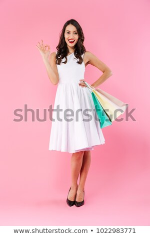 teljes · alakos · portré · csinos · lány · ruha · befogja · száját - stock fotó © deandrobot