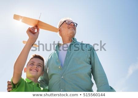 старший · человека · мальчика · игрушку · самолет · небе - Сток-фото © dolgachov