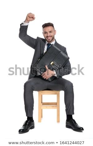 Jonge zakenman aktetas vieren Stockfoto © feedough