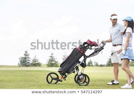 Para golf klub patrząc inny Zdjęcia stock © Kzenon