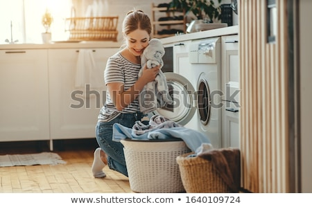 Woman laundry in the room Stock photo © colematt