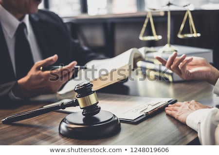 Photo stock: justice and law concept.Male judge in a courtroom working on woo