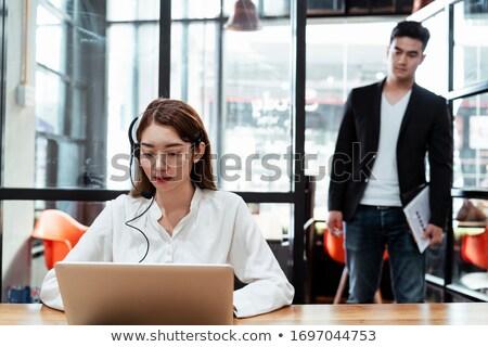 business woman peeking behind a door Stock photo © 3dmask