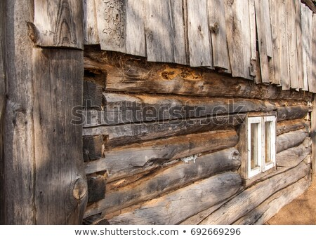 Ancient window on log house wooden wall Stock photo © franky242