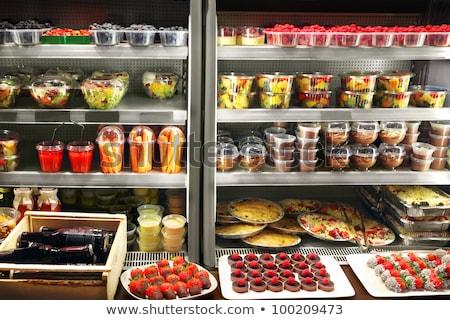 Különböző étel hűtőszekrény egymásra pakolva műanyag bolt Stock fotó © AndreyPopov