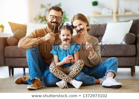 Father and daughter with moustache on stick.  Stock photo © choreograph