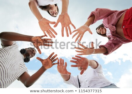 Low Angle View Of People Making Circle With Their Hands Stock photo © AndreyPopov