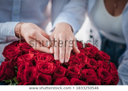 Wedding rings red roses over white background Stock photo © amok