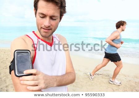 男性 ランナー イヤホン 腕 バンド ビーチ ストックフォト © dolgachov