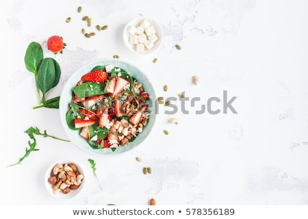 fresh salad with arugula strawberries feta cheese and nuts stock photo © illia