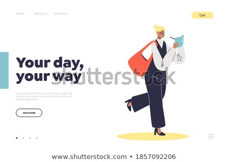 Young businesswoman or student making notes on page of notebook Stock photo © pressmaster